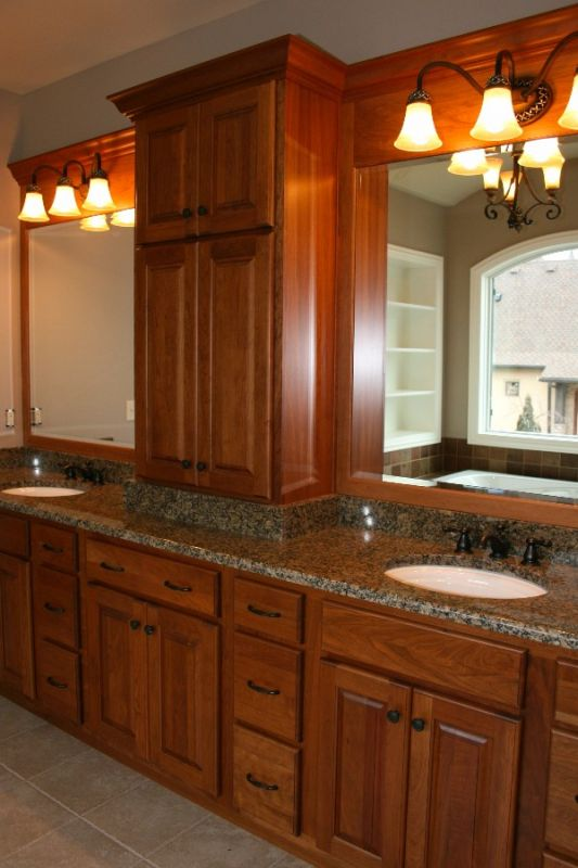 double sinks and bright finish bath counter with large cabinet space